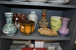 A selection of planters and vases, various styles and eras.