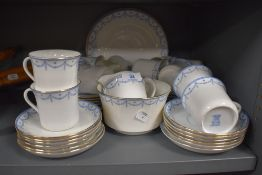 A part tea service having blue transfer print and gilt edging by S&NL Elite