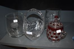 Four pieces of glass,including etched vase,basket and rectangular vase,also a coloured lidded pot.