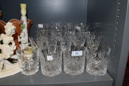 A selection of moulded drinks glasses,including wine glasses and tumblers.