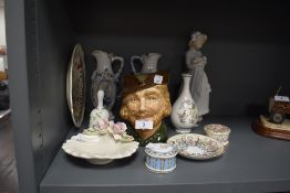 A selection of ceramics including Nao figurine Royal Doulton Robin hood jug and more.