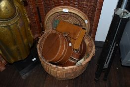 A selection of leather collar and wash bag cases in a woven fibre basket