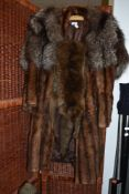 A brown mink coat a fox fur stole and a taxidermy fox wrap with head and feet