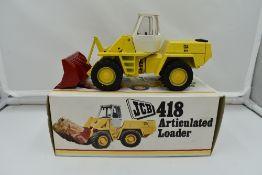 A 1:35 scale NZG Modelle diecast, JCB Articulated Loader 418 in original box 142
