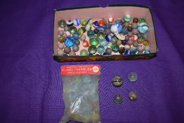 A small selection of mixed vintage glass and clay marbles including three having colourful twist