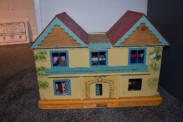 A GB Toys wooden two storey Dolls House named The Beeches, having tin plate windows with a selection