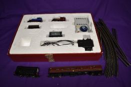 A Bachmann 00 gauge Digital Starter part train set, comprising two loco's, two wagons, controller