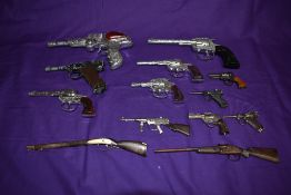 A selection of 1960's and later Toy Cap Guns BCM style Space Outlaw, Crescent Bronco, Lone Star Cody