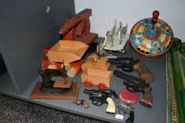 A selection of vintage toys comprising, Tri-ang tin plate Crane and Spinning Top, a childs tin plate