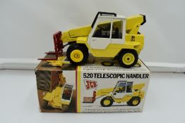 A 1:35 scale NZG Modelle diecast, JCB Telescopic Handler 520 in original box 175