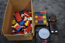 A selection of 1970/80's Lego including figures, a wooden block set, a Tomy 1979 Missile Strike