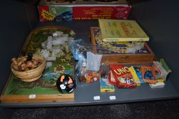 A shelf of vintage toys and games including French Jeu De L'oie folding board game, Scrabble