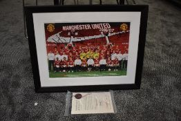 A framed print, Manchester United 2006/07 Squad, bearing several signatures with certificate of