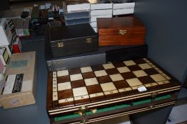 Three modern Chess sets, one in a Jaques box, a selection of Chess related video cassettes and a