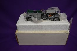 A Franklin Mint 1:24 scale diecast model, 1907 Rolls Royce Silver Ghost, in original polystyrene