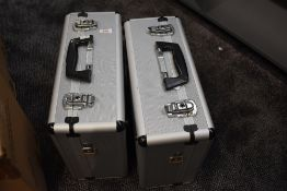 Two alloy camera cases