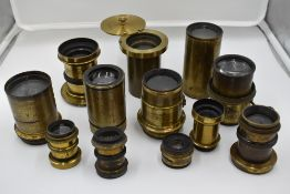 A selection of twelve brass lenses including 8 inch, Optimus etc