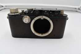A Leica 1F camera body in leather case Circa 1933. Serial No 109925