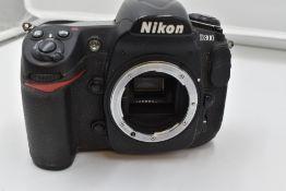A Nikon D300 camera body in original box with manual
