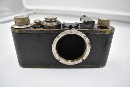 A Leica 1C camera body in leather case Circa 1931. Serial No 64481