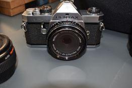 A Pentax MX with 40mm, Pentax M lens, Pentax m 80-200mm lens, a Sigma UC Zoom 28-105mm, Pentax M
