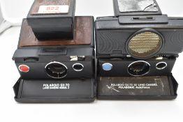 Two Polaroid cameras. An SX-70 Land Camera Palasonic Auto focus and a Model 2
