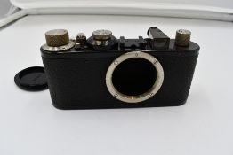 A Leica 1E camera body in leather case Circa 1932. Serial No 104542