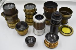 A selection of nine predominantly brass lenses including Ross, R & J Beck and de Maria, Paris