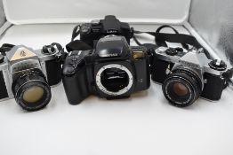Four cameras, a Pentax S3 with Auto/Takumar 55mm lens, a Pentax Z-20 body, a Pentax ME Super, and