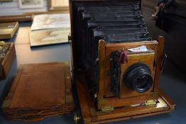 A Mahogany cased field camera by R & H Robbins, Exchange Street Liverpool with a Ross lens and