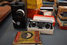 A Dekko cine camera in original box, a pair of pocket binoculars in original box etc SELLING IN