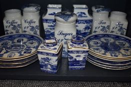 A selection of blue and white wear ceramics including Ringtons vase and caddy pairs