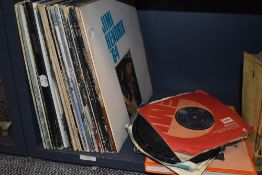 A selection of vinyl albums and singles including The Beatles interest