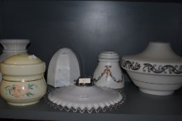A selection of Art Deco and later pressed glass light shades including ribbon design and hand