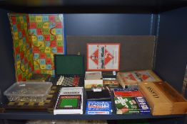 A selection of travel and table top childrens board games including Monopoly and Snakes and ladders