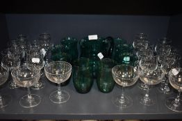 A selection of clear cut and crystal glass wares including star etched cocktail glasses and