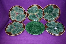 A set of five antique Majolica styled plates having naturalistic leave design in fair to good
