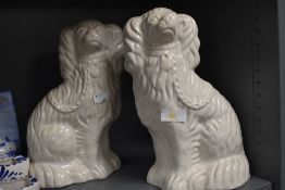 A pair of Staffordshire mantel dogs.