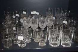 A selection of clear cut and crystal glass wares including wine and cocktail