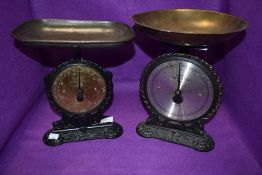 Two sets of Salter scales one antique set having brass dial face and cast base both sets are No.45