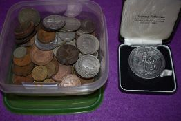 A selection of collectable coins and currency including crown and shillings