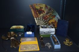A selection of curios and trinkets including Burnley penny saver and semi precious mineral stones