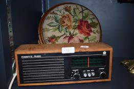 A Roberts RM30 radio receiver and an oak foot stool with embroidered top