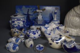 A selection of blue and white wear ceramics in Dutch delft designs including tiles