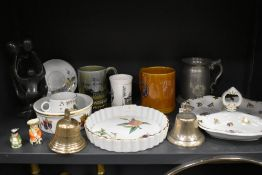 A selection of ceramics including Royal Worcester Evesham and two cast bells