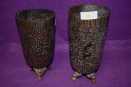 A pair of Indian tall stem chase work vase having cast three footed bases