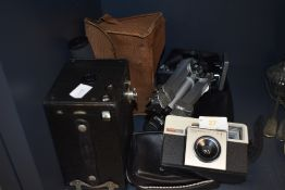 A vintage box camera, a Kodak instamatic 25 and a Velbon tripod.