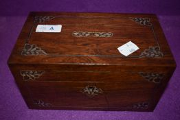 An antique tea caddy having mother of pearl and metal inlay and banding with good inner
