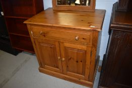 A pine cabinet, suitable for a variety of uses, with computer or entertainment style top drawer,