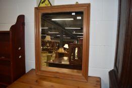 A modern pine wall mirror, approx. 56 x 71cm